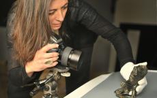 Lysiane Gauthier photograhping an archeologic artefact. Photo F. Deval City hall of Bordeaux